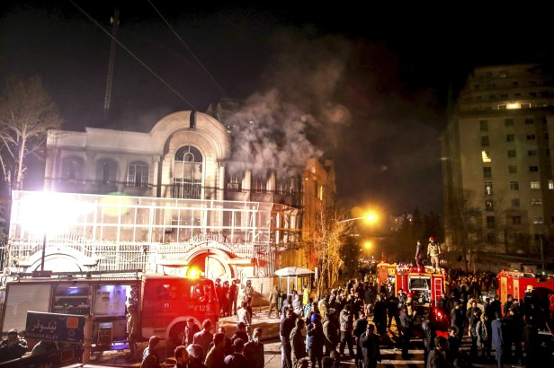 Flames rise from Saudi Arabia's embassy during a demonstration at in Tehran